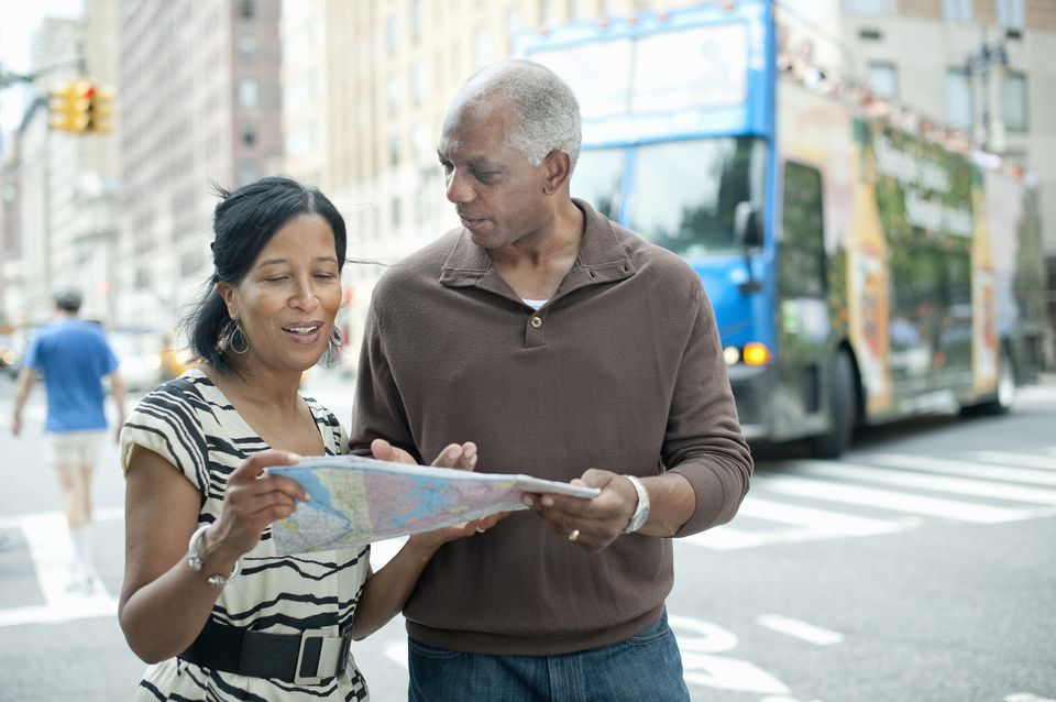 Senior Couple Looking at Map on City Street