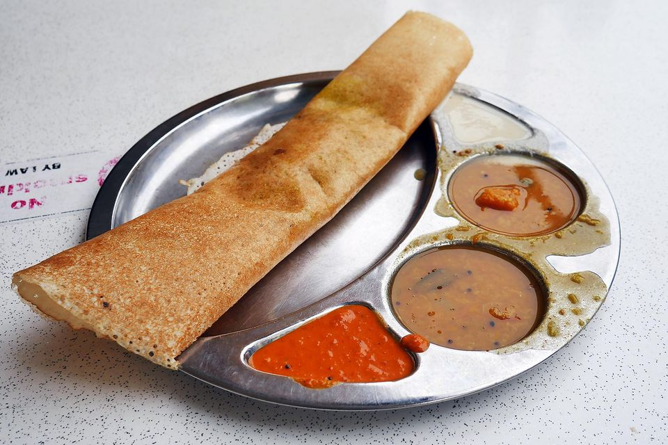 Close-Up Of Dosa Served In Plate On Table