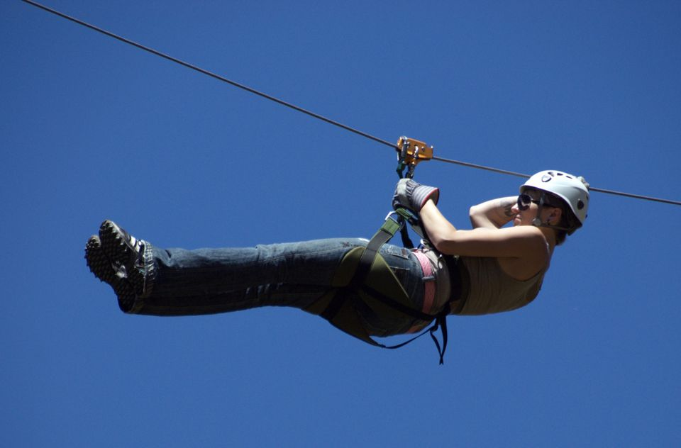 Woman flying along on 'Zipline'
