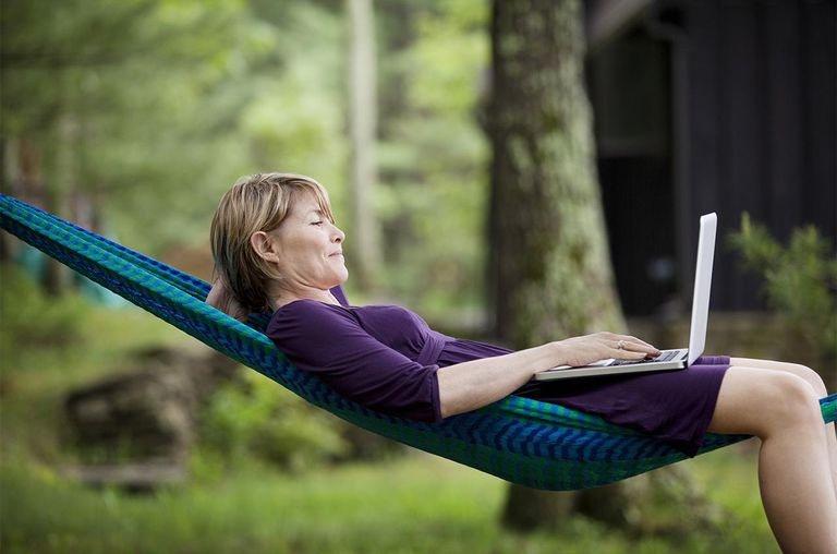 Woman Laying On Hammock With Computer