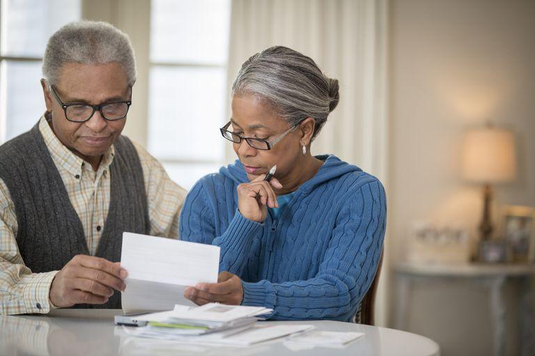 Senior African American couple paying bills
