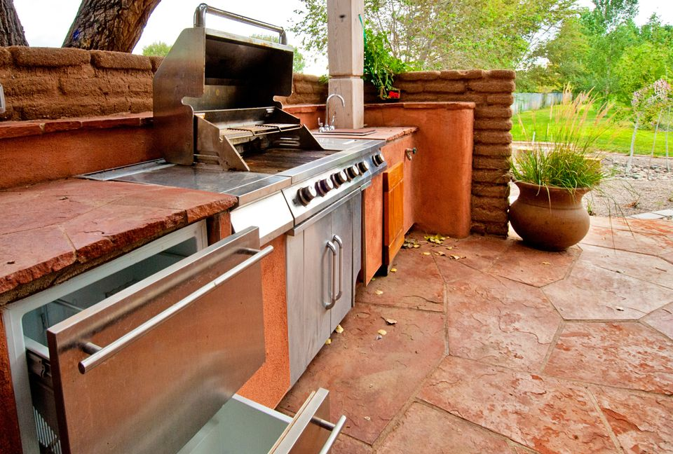 Built-in grill in an outdoor kitchen