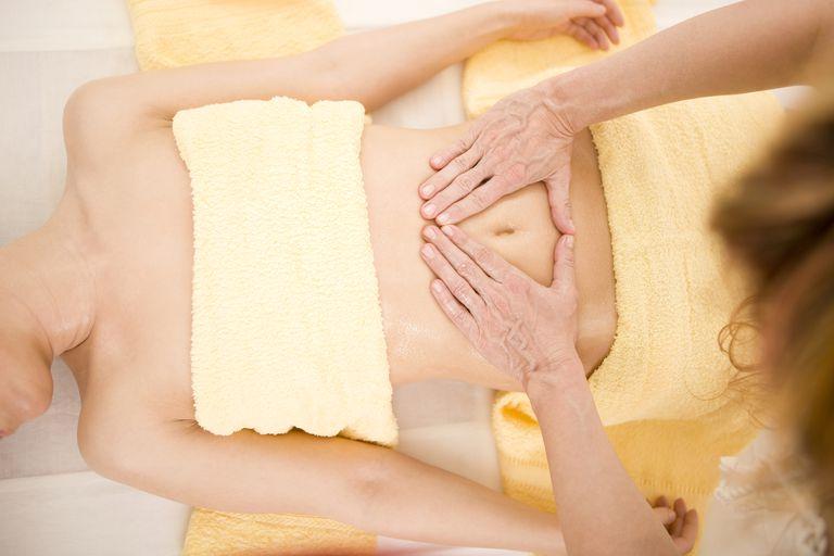 Woman receiving abdominal massage