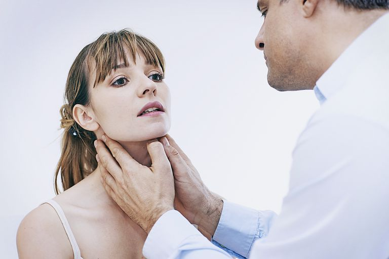 Doctor palpating a patients Lymph Nodes