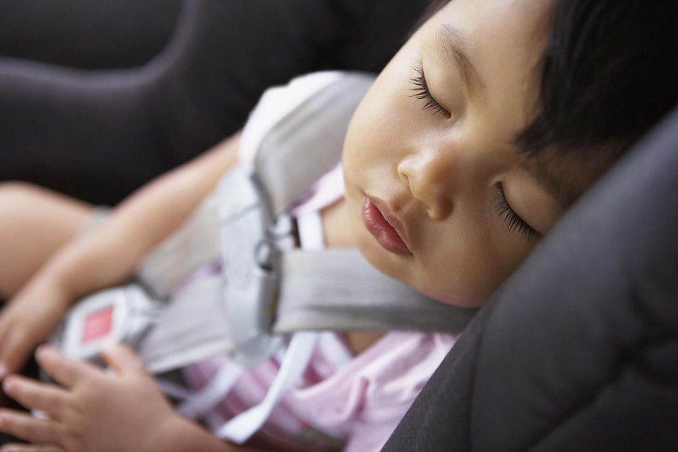 Baby sleeping in a carseat