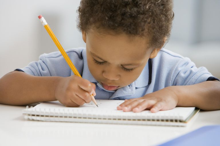 Boy Writing in Notebook