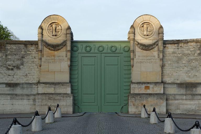 "Main Entrance to the Père Lachaise Cemetery, in Paris, engraved with the words ""SPES•ILLORUM / IMMORTALITATE / PLENA•EST Sapient III IV"" and ""QUICREDIT IN ME / ETIAM SI MORTUUS / FUERIT VIVET Jean XI"""