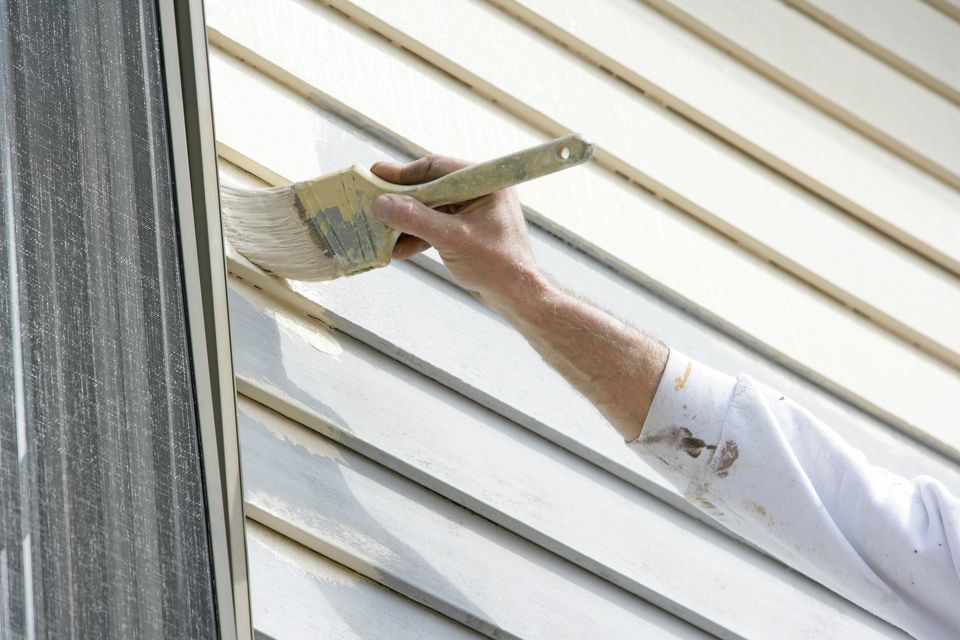 Painter performing trim work in house