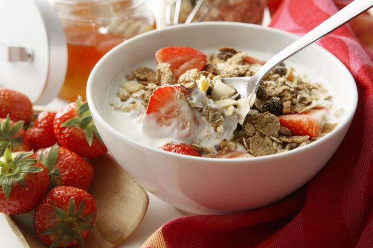 Milk and Cereal in bowl with Strawberries