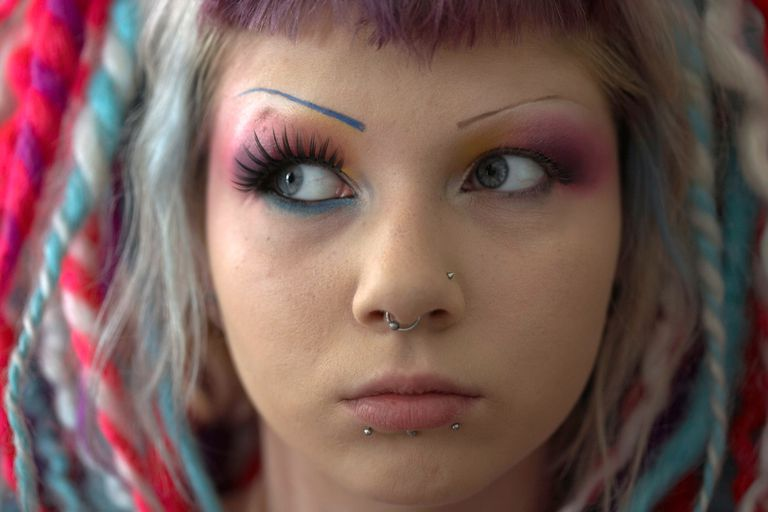Close-up of a woman's face with make-up and facial piercings, Kiev, Ukraine