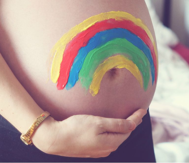 Pregnant belly - rainbow baby