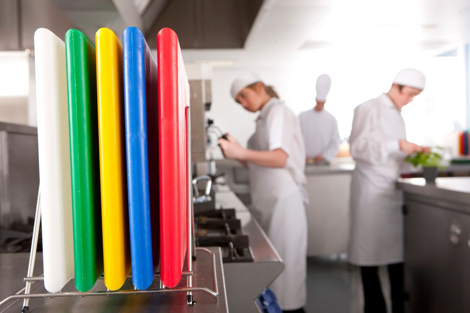 Color coded cutting boards in a commercial kitchen