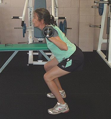Squat with barbell.
