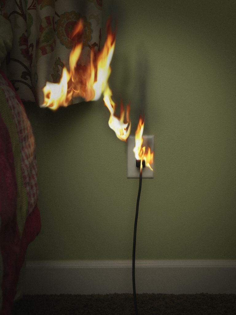 Electrical outlet and curtain on fire