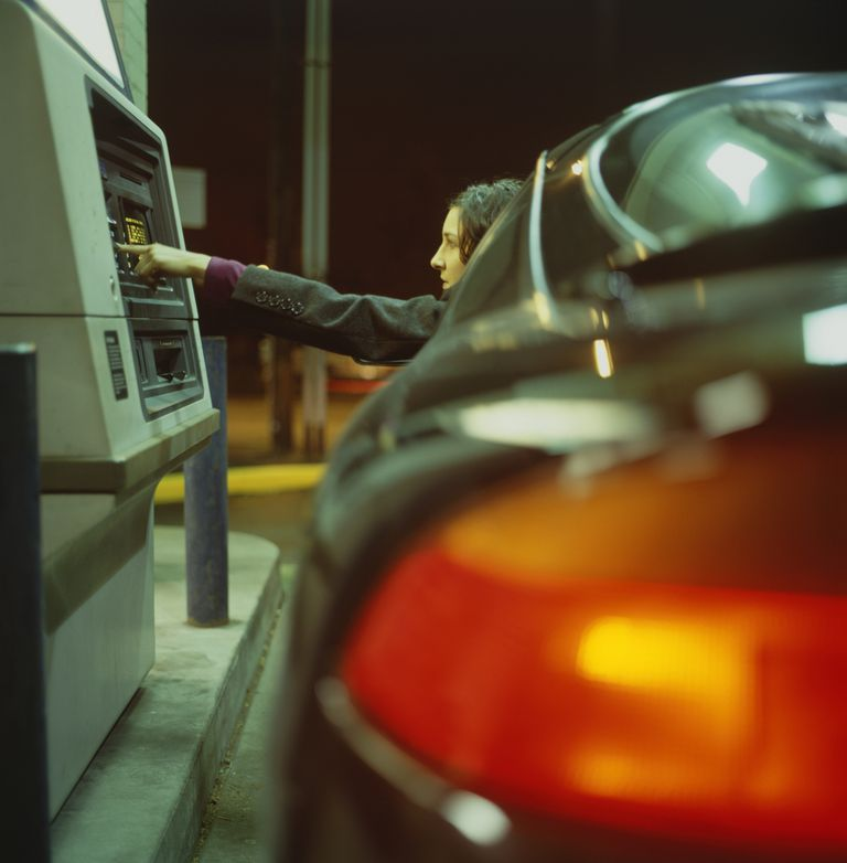Young Woman using Drive-Through ATM