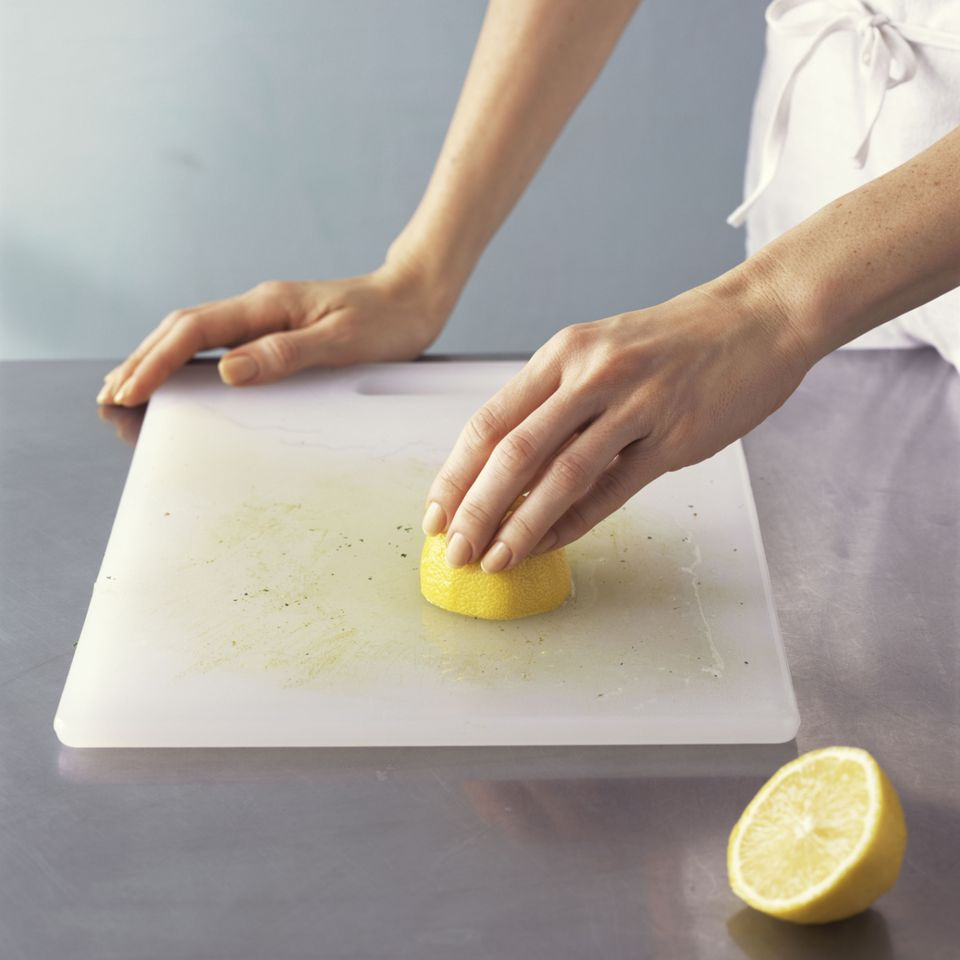 using lemon to clean cutting board