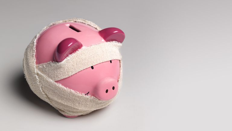 Ill piggy bank with bandages