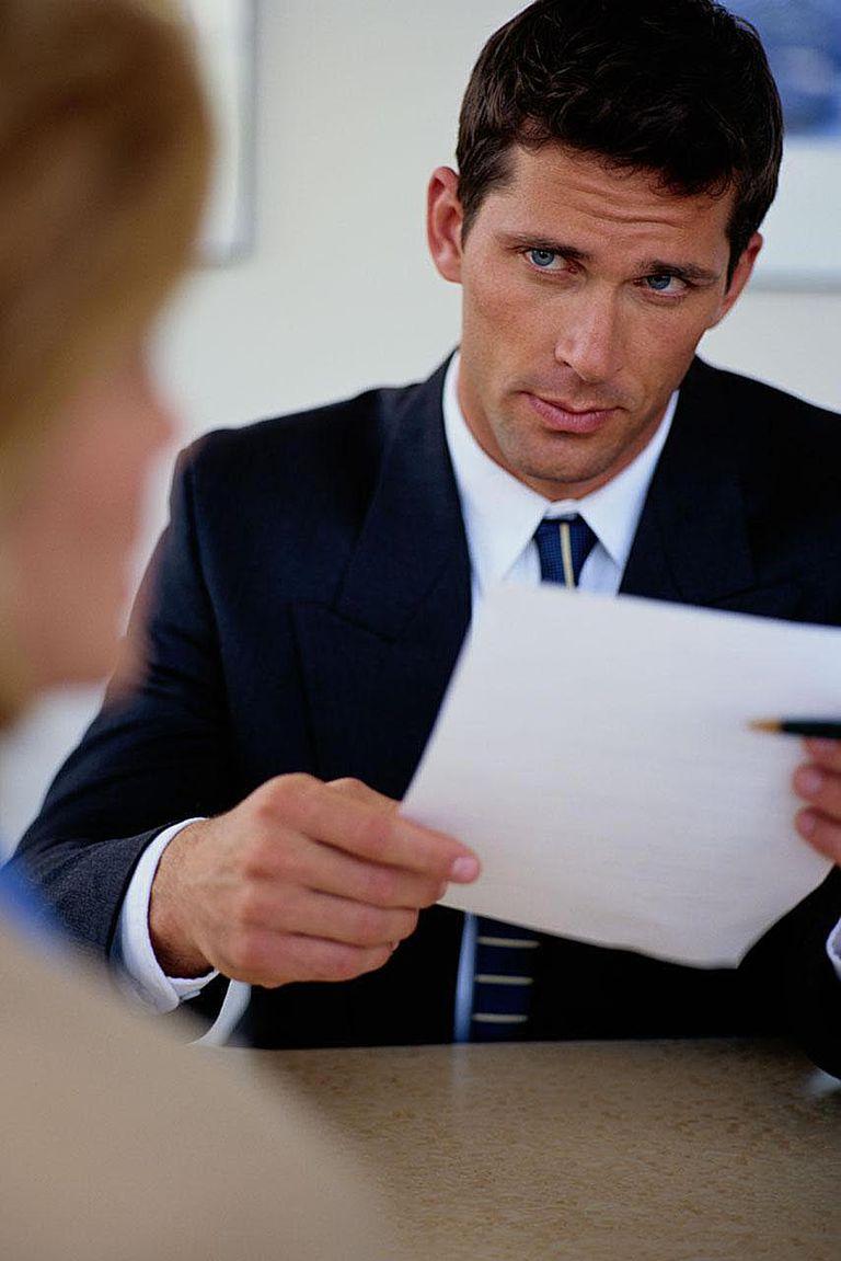 Businessman Scrutinizing a Job