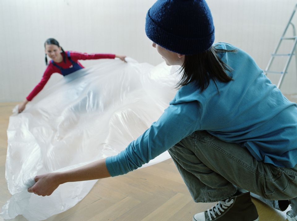 Laying Plastic Sheet on Flooring
