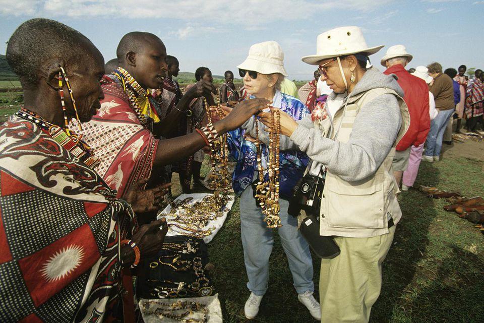 Kenya, Masai tribeswomen selling beads to tourists