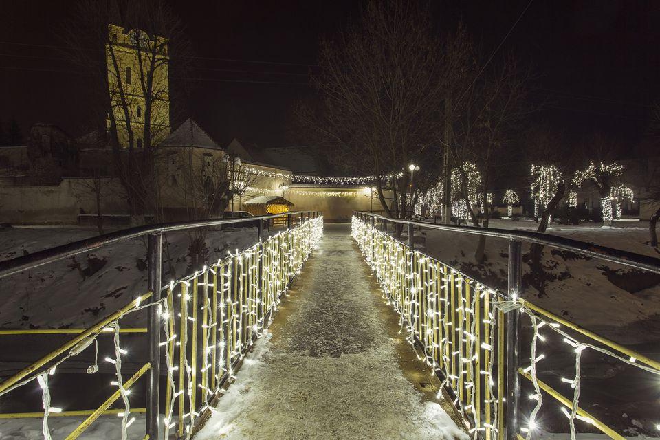 Bridge of light in the night in winter time