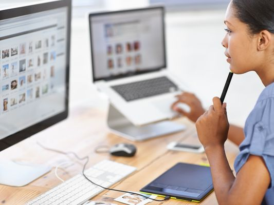 Woman looking at photos on computer