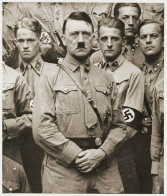 Adolf Hitler poses with a group of Nazis soon after his appointment as Chancellor.