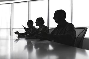 Silhouette of business people negotiating at meeting table