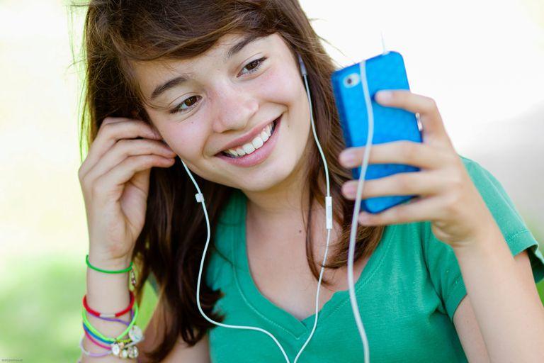 Teenage girl listening to iPod