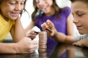 Children stacking coins