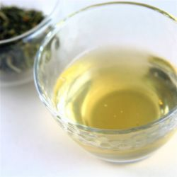 An image of Green Tea Vodka and the Yuzu Sencha tealeaves used to infuse it.