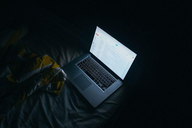 Computer illuminated in the dark