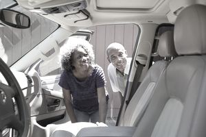 African American Couple Leasing a Car