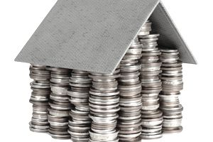 coins forming shape of house