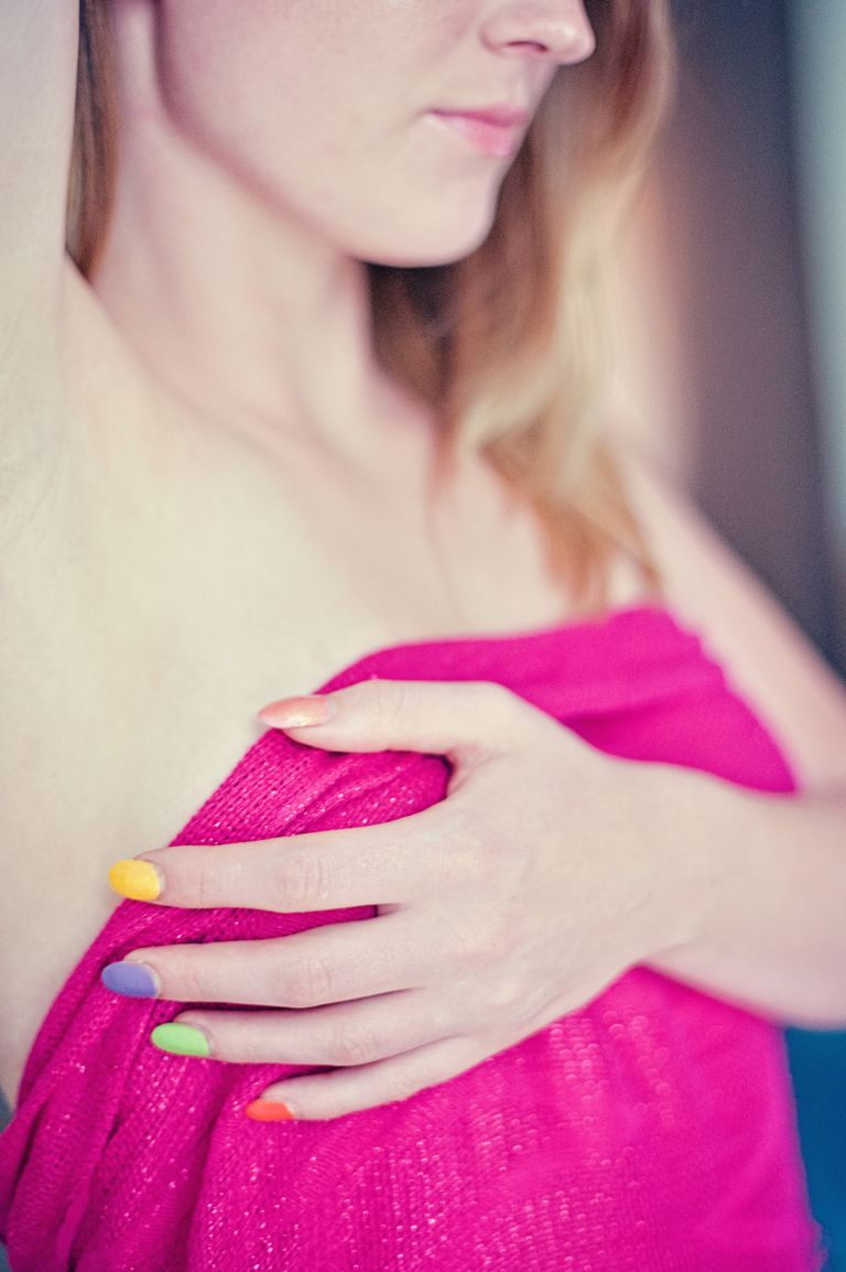 young woman touching breast
