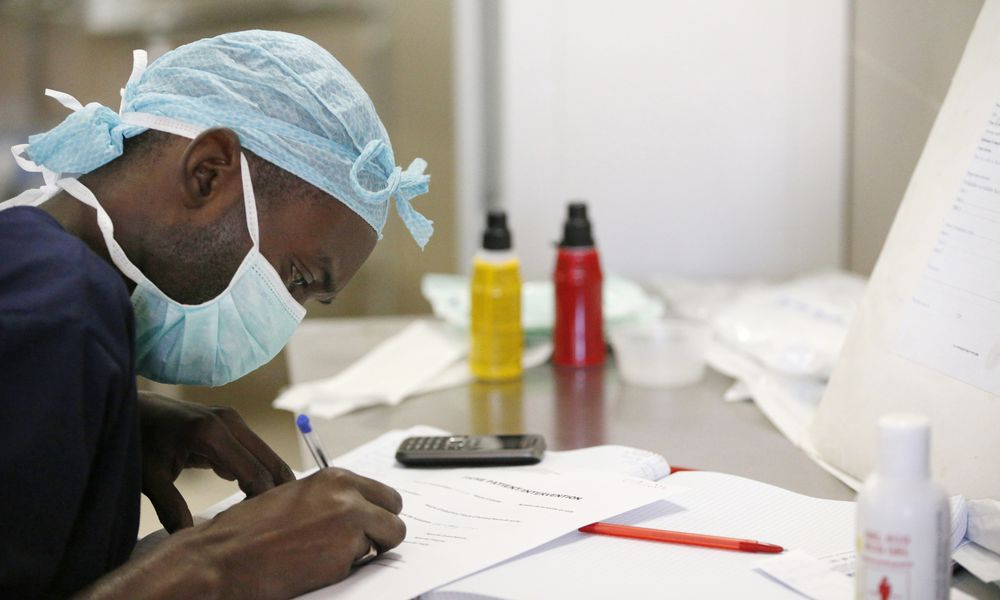 Anesthesiologist with cellphone nearby