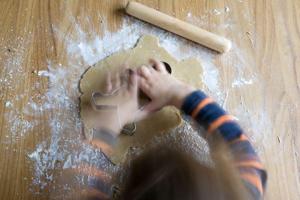 toddler making gingerbread man