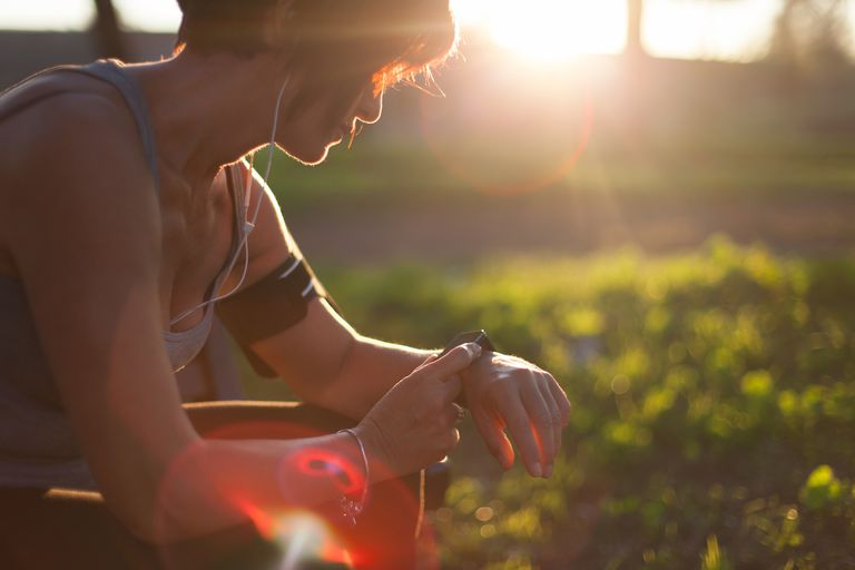 Woman checks stopwatch
