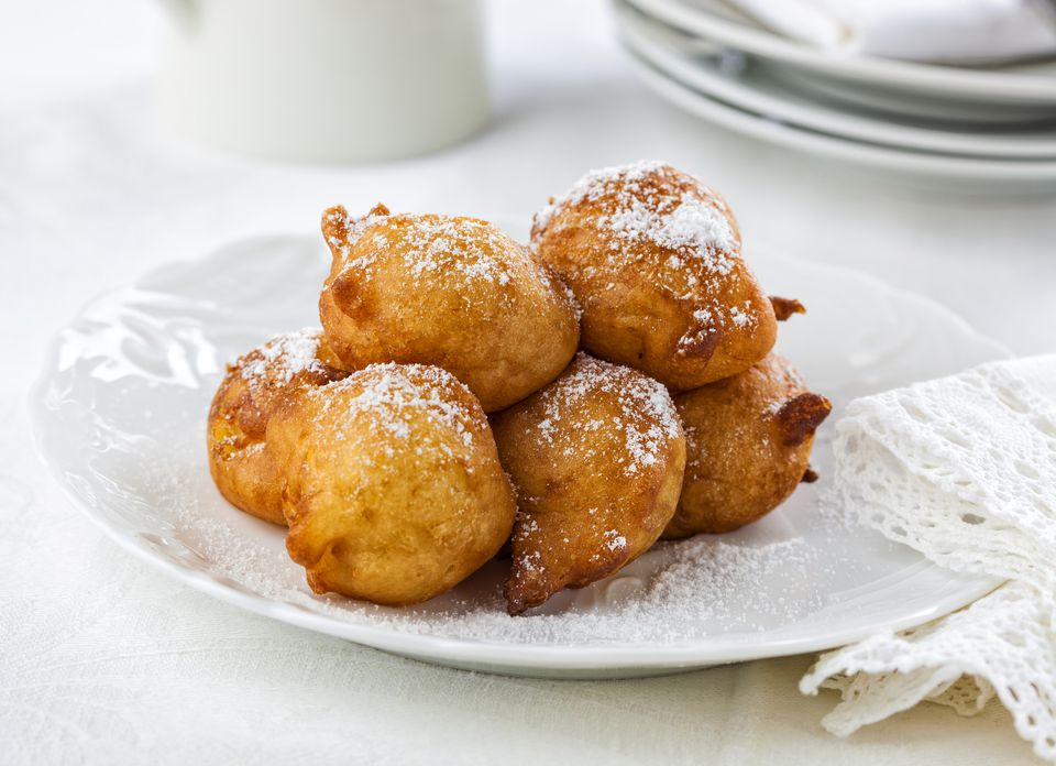 fried dough balls topped with powdered sugar