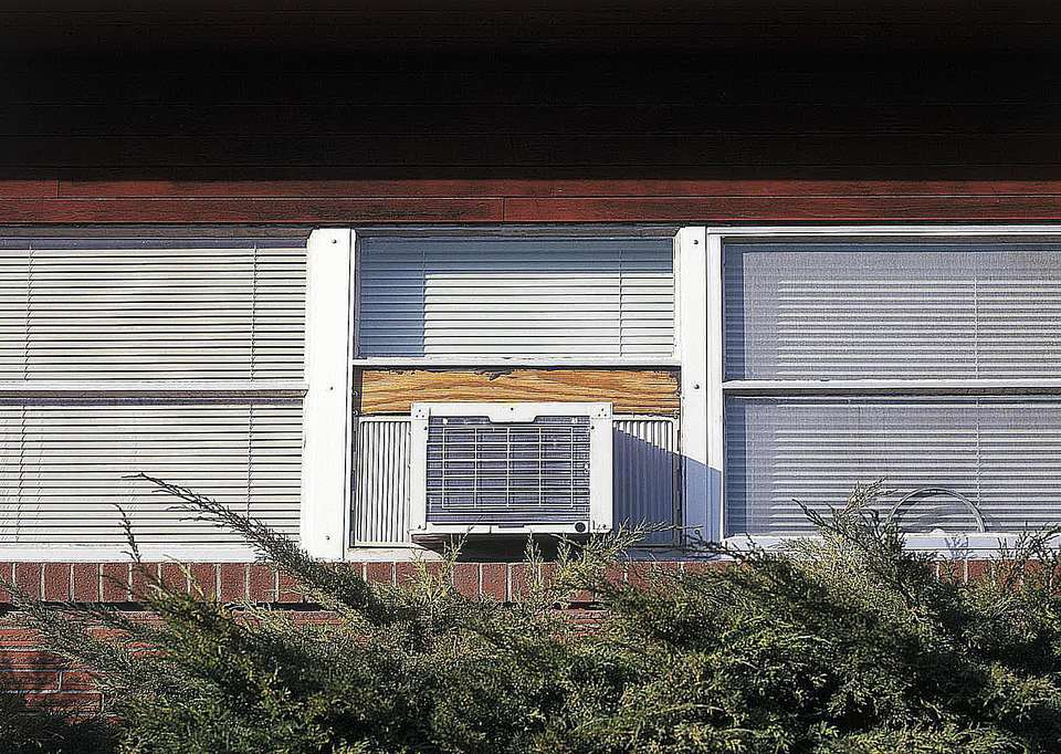 Air conditioning unit in window, low angle view