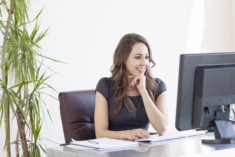 Smiling businesswoman working in an office