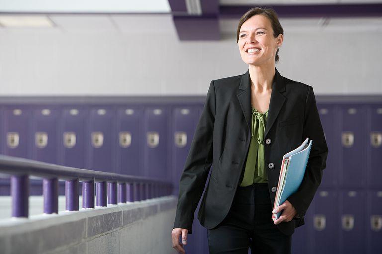 A teacher walking down a corridor