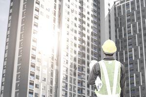 construction engineer at large condominium building site