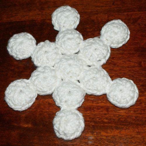 Snowflake-Shaped Crochet Bottle Cap Trivet