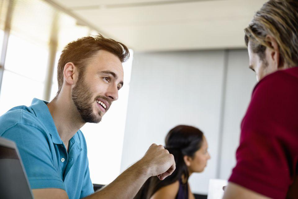Man having conversation with coworker