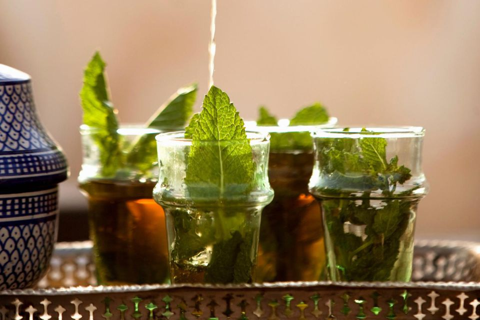 Fresh mint tea being poured