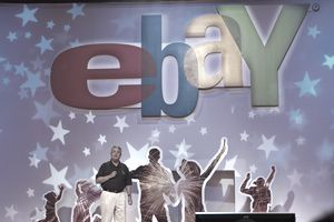 People silhouetted with the Ebay logo and stars
