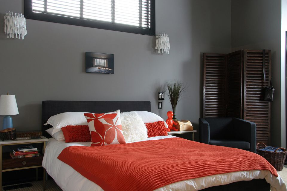 Grey and orange bedroom.