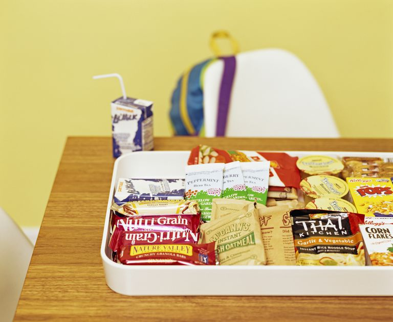 Tray filled with various packets of soup, cereal and snacks