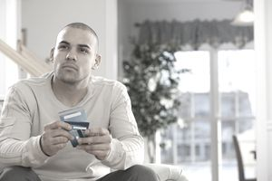 Man making decision about his credit cards